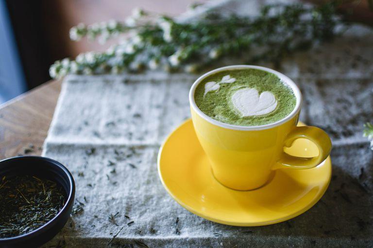Green tea in yellow teacup
