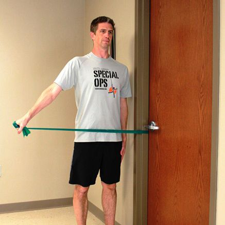 Man doing shoulder abduction exercise with resistance band