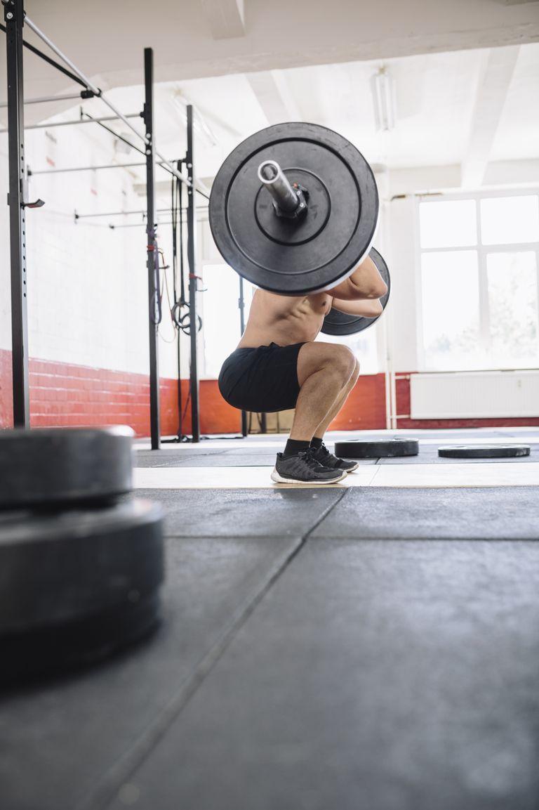 man doing squat exercise