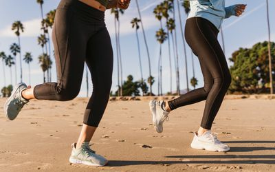 two women running on the beach