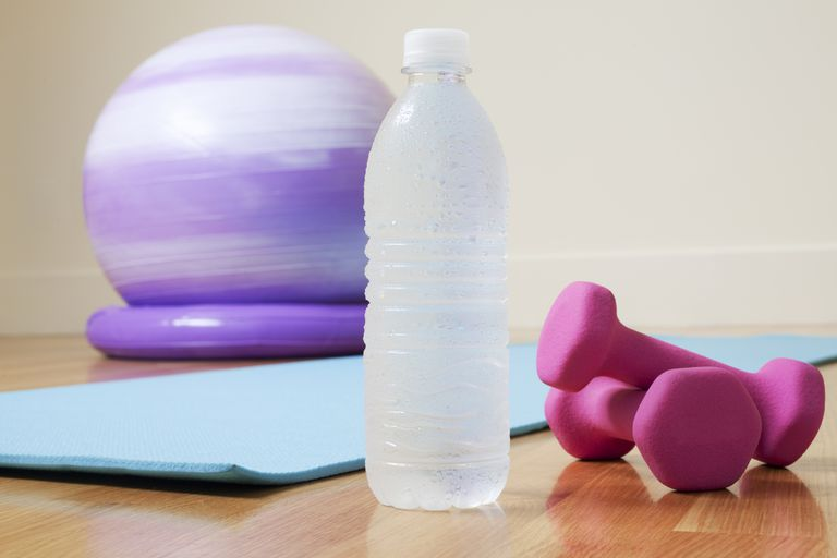 Exercise ball, pink dumbbells, mat and water bottle