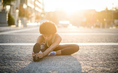 Woman stretching on the street
