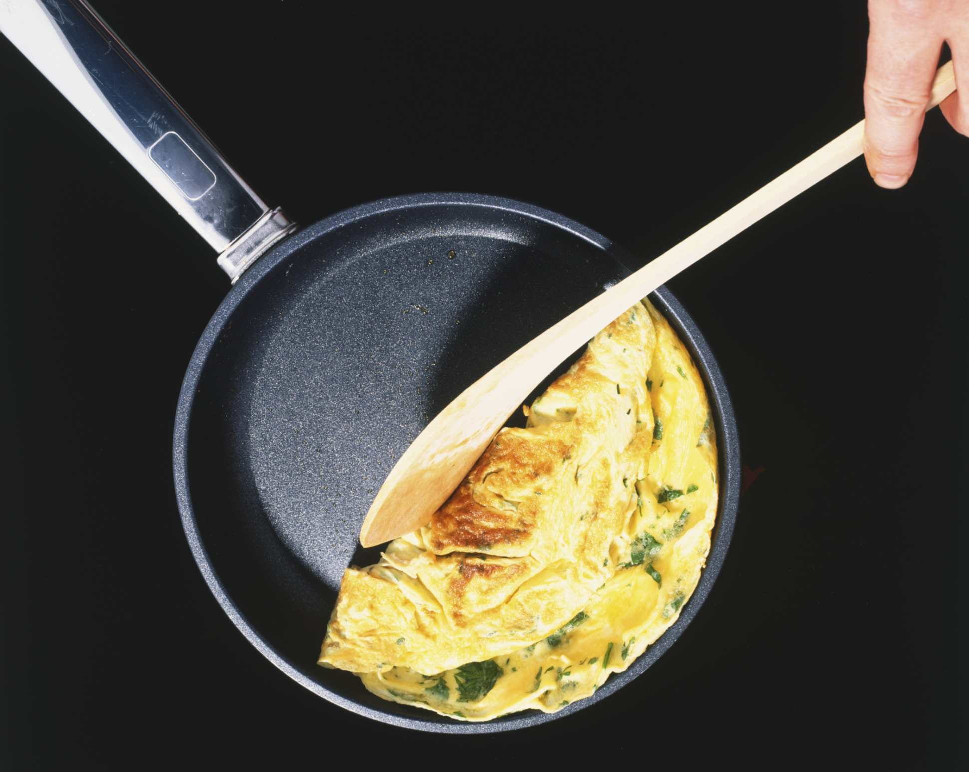 non-stick pan with wooden spoon