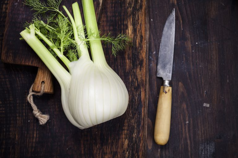 Fennel on chopping board and kitchen knife