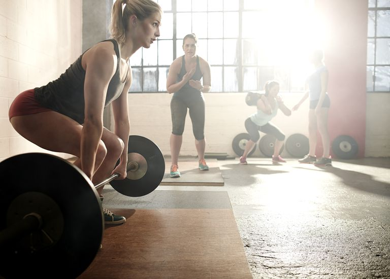Strong female preparing for powerclean