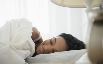 Mixed race woman sleeping