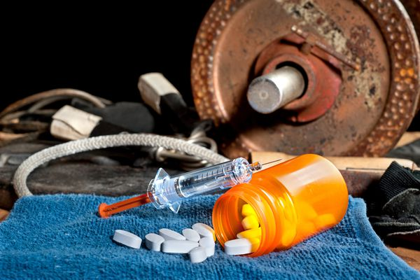 Barbell and pills and syringe
