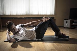 Young, black woman (28) at her apartment in Strombeek (Belgium), working out