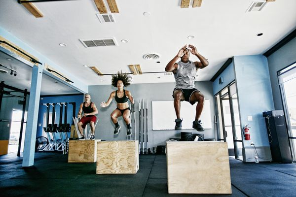 people jumping up on crossfit boxes
