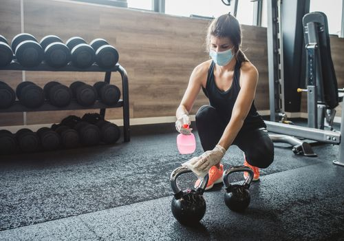 Woman cleaning gym
