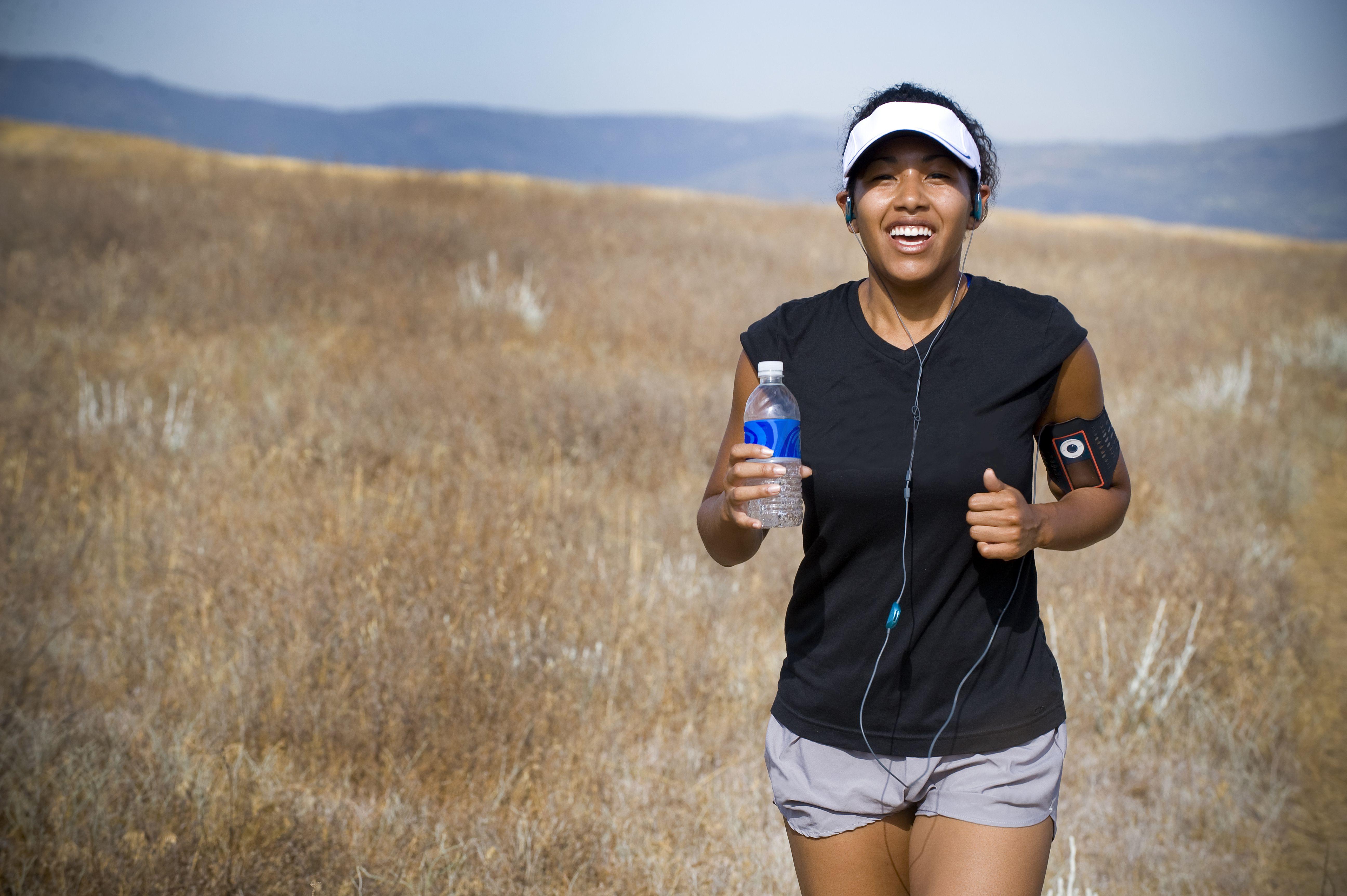 Women running with water