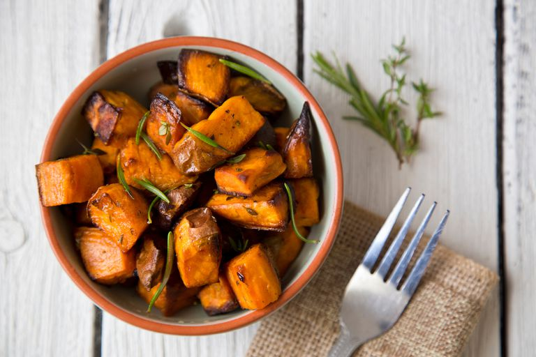 Roasted sweet potatoes and herbs