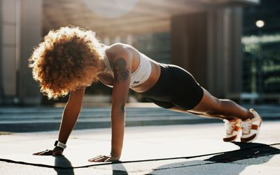 Strong woman in a plank