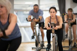 Woman taking an indoor cycling class