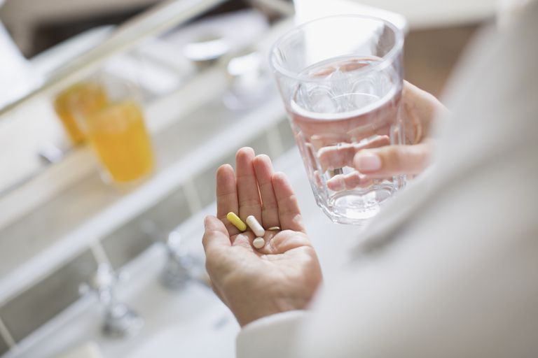Person taking supplements