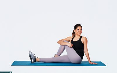 woman doing seated IT band stretch