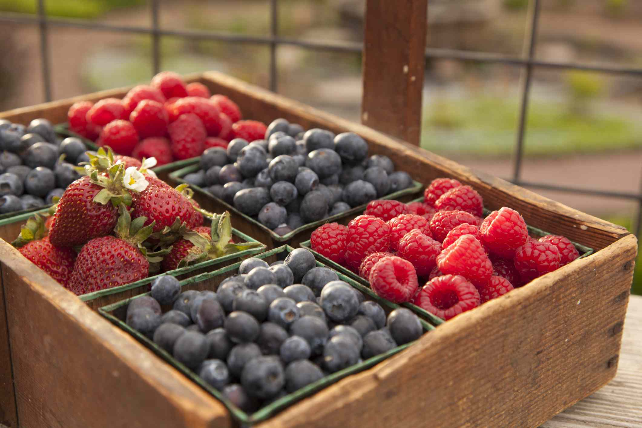 Wooden container with blueberries, raspberries, and strawberries