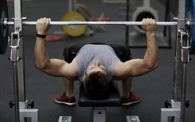 Man training with weights in gym
