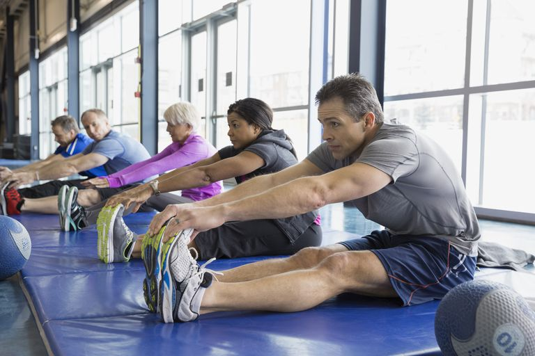 Group stretching in exercise class at gym