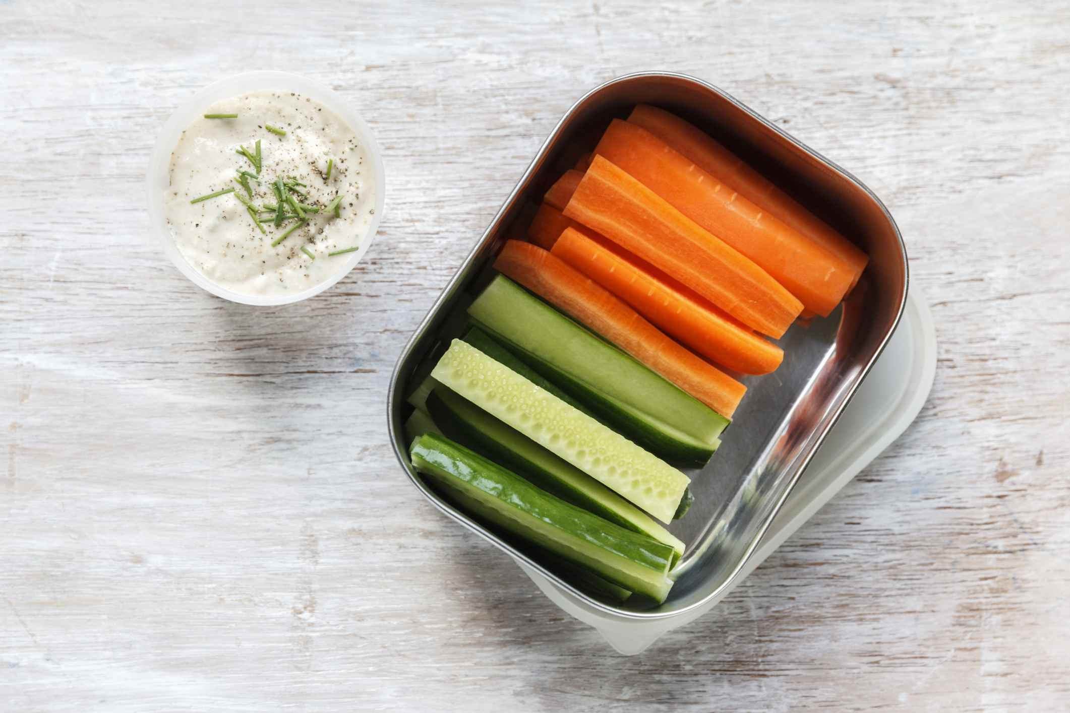 Carrots, zucchini and veggie dip make a healthy snack for work.