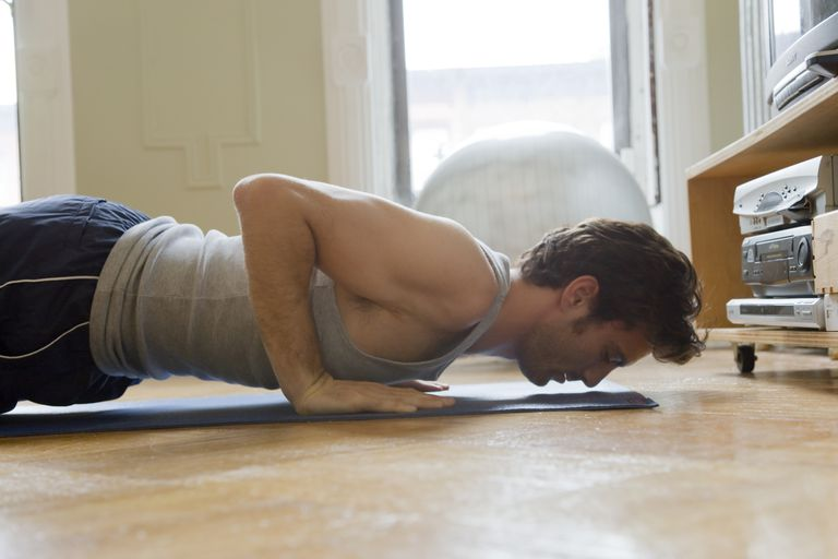 man doing push ups in living room