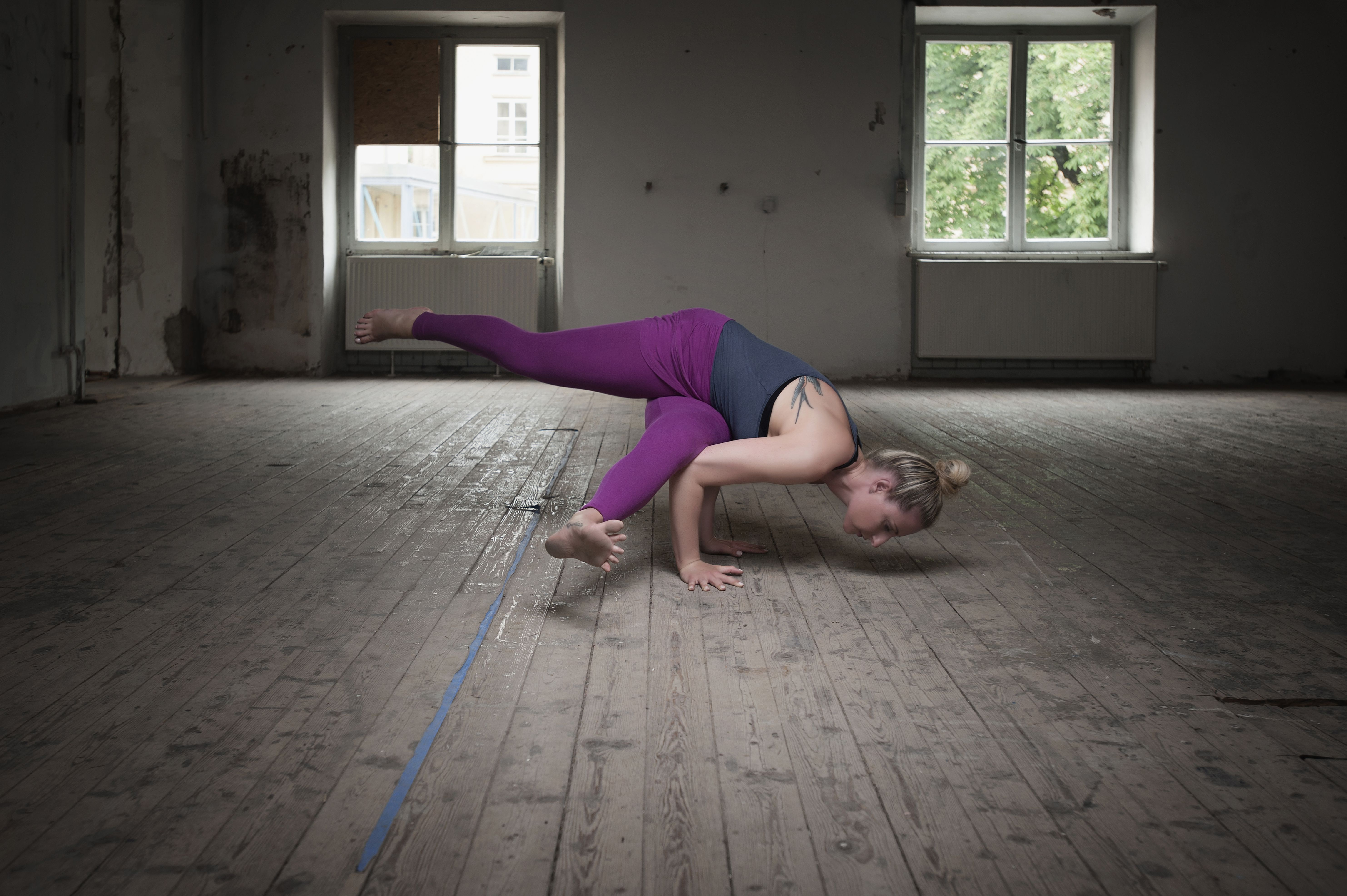 Woma in eka pada koundinyasana I yoga pose.