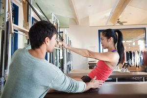Woman having private pilates training session