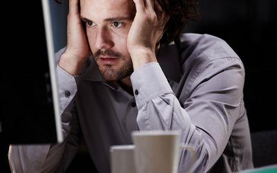 Man Stressed Sitting at Computer