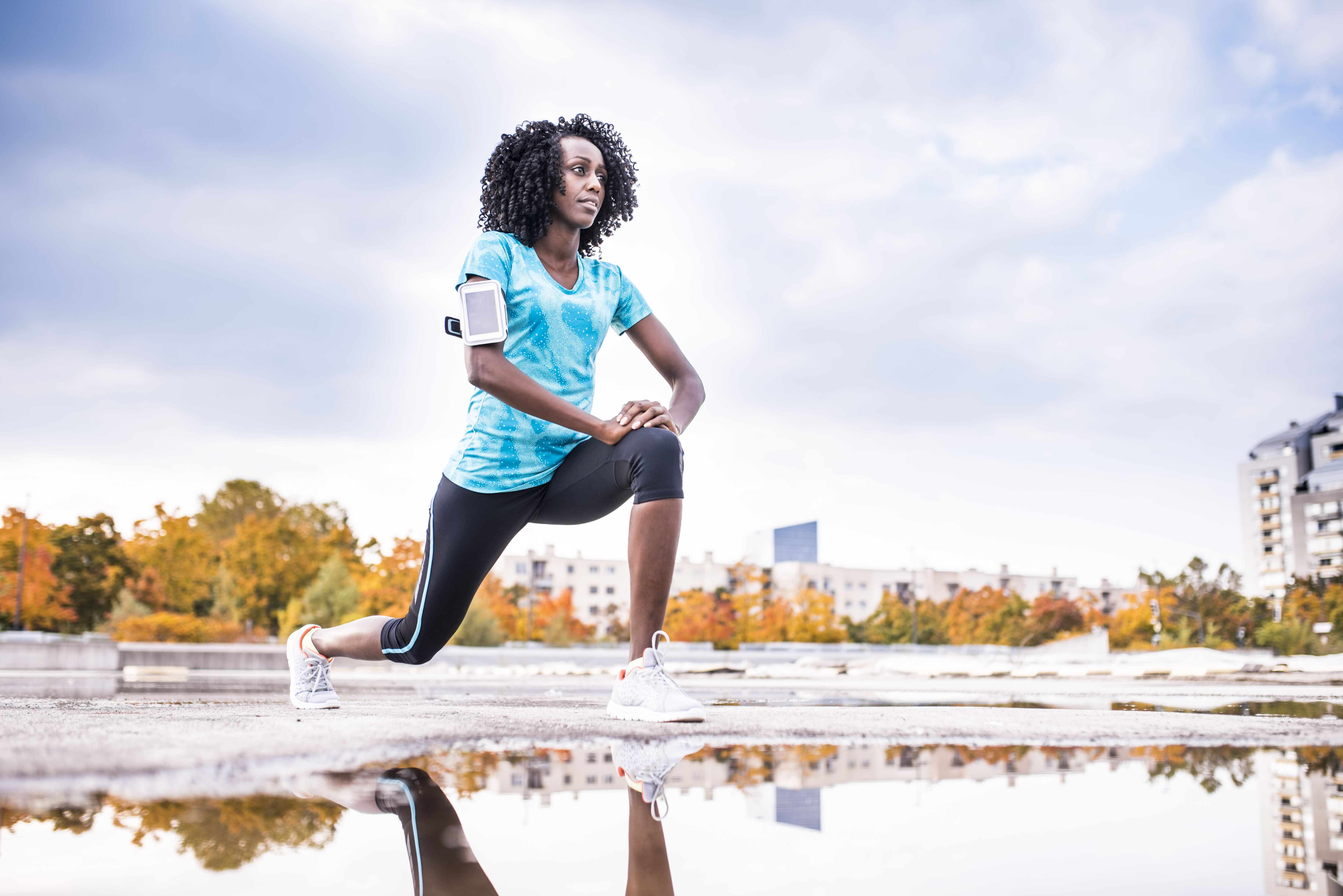 Black woman in forward lunge position