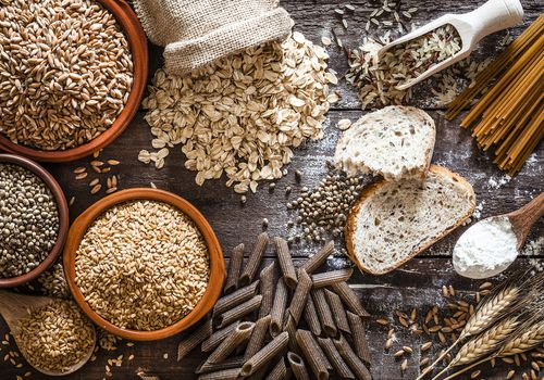 Whole grain food on rustic wooden table
