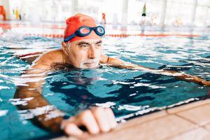 Man in pool holding edge