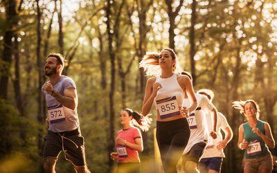 People running a marathon in a park