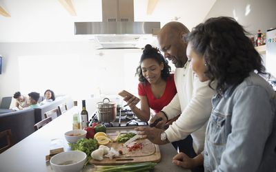 Dad cooking with daughters