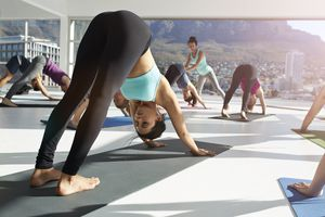 Yoga class in Downward Facing Dog Pose