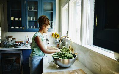 Woman washing vegetables
