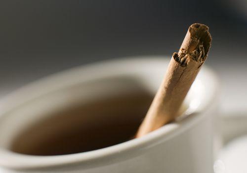 Tea and a cinnamon stick.