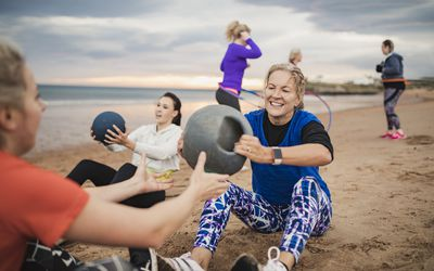 Mature Woman Doing Weighted Ball Exercises