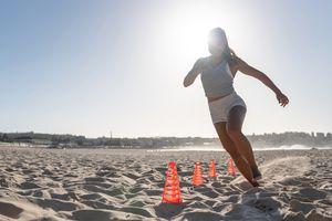 Beautiful woman exercising at the beach