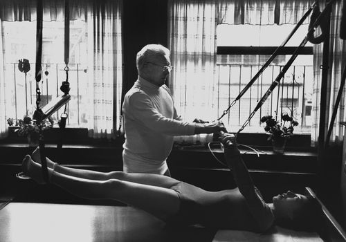 Joseph Pilates works with a client in 1961.