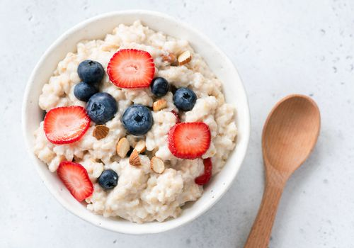 Oatmeal served with berries and almonds