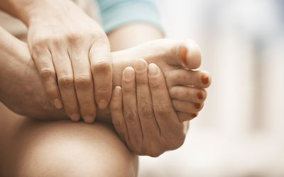 Woman feeling foot pain. Close-up horizontal view