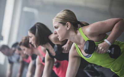 women doing push-ups and lifting weights