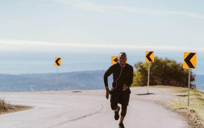 man running fast uphill