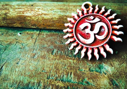 om pendent on wood texture background and greeting