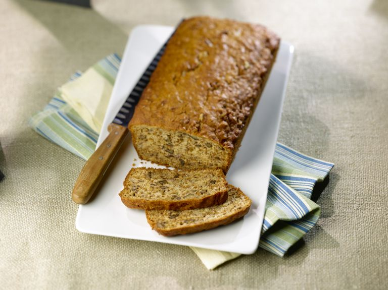 Banana bread on white plate with knife
