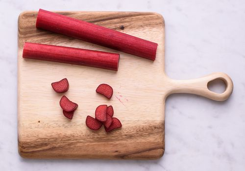 Rhubarb sliced on a cutting board