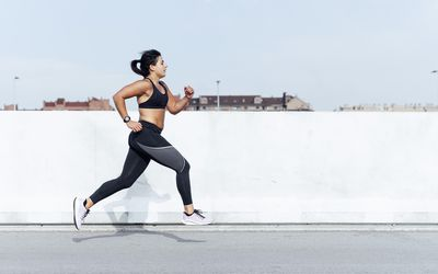 woman running outdoors on road
