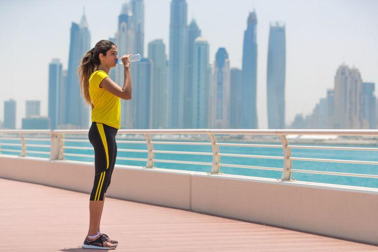 Woman drinking water on her run
