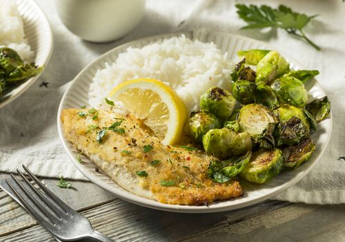 Plate of fish, Brussels sprouts, and white rice