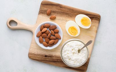 group of protein sources including eggs, almonds, and cottage cheese